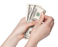 Female hands counting money. Isolated on white background stock images