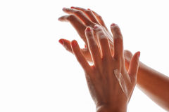Female hands with cream isolated Royalty Free Stock Images