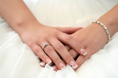 Female hands crossed with engagement ring Royalty Free Stock Image