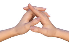 Female hands with crossed thumbs and interlaced fingers