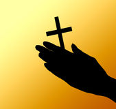 Female hands with crucifix over brown Stock Image