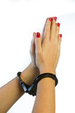 Female hands in cuffs in pray Royalty Free Stock Photography