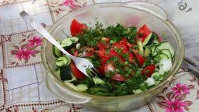 Female hands cut vegetables for vegan salad stock video footage