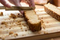 Female hands cutting and preparing cake crust Stock Photos