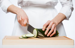 Female hands cutting zucchini Royalty Free Stock Photos