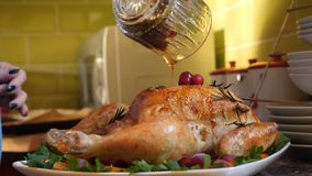Female Hands Decorate Roasted Whole Chicken on Plate For Family Dinner Stock Images