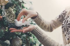 Woman decorating christmas tree, new year decoration background Royalty Free Stock Images