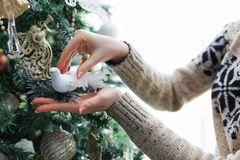 Woman decorating christmas tree, new year decoration background Royalty Free Stock Photography