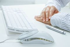 Female hands on desk Stock Photography