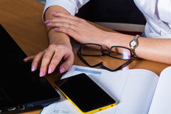 Female hands on the desk Royalty Free Stock Images