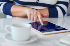 Woman using digital tablet, view close up. Female hands with a digital tablet shopping at online shop royalty free stock images