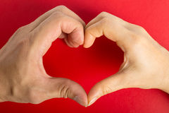 Female hands do hands heart. On valentine day royalty free stock images
