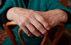 Female hands. Hands of an elderly woman lying on a chair Stock Photo