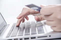 Shopping online with credit card on laptop Royalty Free Stock Photos