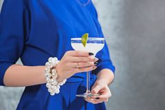 The exotic cocktail and female hands. The female hands and exotic cocktail at studio Royalty Free Stock Photo