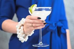 The exotic cocktail and female hands. The female hands and exotic cocktail at studio Stock Photos
