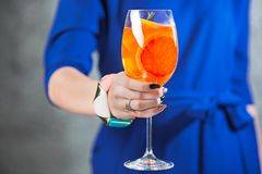 The exotic cocktail and female hands. The female hands and exotic cocktail at studio Stock Image
