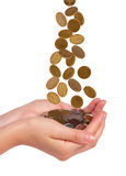 Female hands and falling coins royalty free stock image