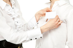 Female hands fastening badge Royalty Free Stock Photo