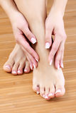 Female hands and feet Royalty Free Stock Photo