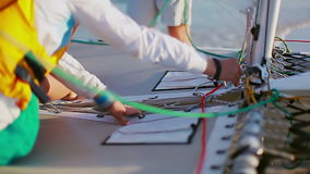 Female hands fixing the mount before departure on the sail stock footage