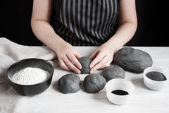 Female hands form the black buns stock photo