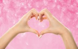 Female hands in the form of heart stock photography