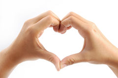 Female hands in the form of heart. Isolated on white background royalty free stock image