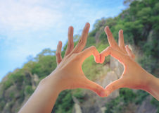 Female hands in the form of heart. Love concept stock photo