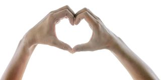 Female hands in the form of heart on white background w. Ith clipping path stock photo
