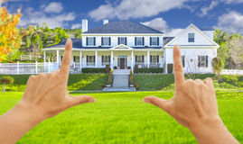 Female Hands Framing Beautiful House Stock Photography