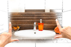 Female hands framing custom bathroom design. Royalty Free Stock Photography