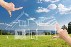 Female hands framing custom house design. Stock Images