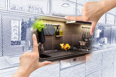 Female hands framing custom kitchen design. Combination drawing and photo royalty free stock images