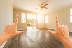 Female Hands Framing Empty Room of House. Female Hands Framing Empty Room of a New House stock images