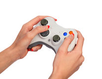 Female hands with a gamepad Royalty Free Stock Photos