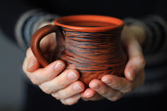 Female hands gently holding a mug of hot chocolate Stock Photos