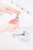 Female hands getting soap for washing Stock Images