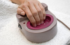 Female hands getting spa procedure Stock Image
