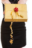 Female hands giving christmas golden gift box with ribbon. Holiday. Stock Images