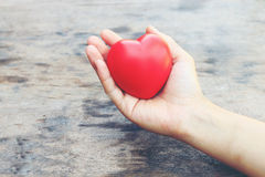 Female hands giving red heart. vintage tone Royalty Free Stock Photos