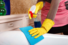 Female hands in gloves cleans sanitary equipment Stock Photos