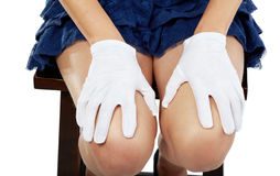 Female hands in gloves lay on knees Stock Photo