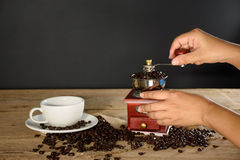 Female hands grinding coffee beans Stock Photo