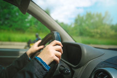 Female hands gripping car steering wheel Royalty Free Stock Photography