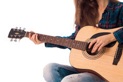 Female hands with guitar. Closeup of female hands with guitar isolated on white background stock photo