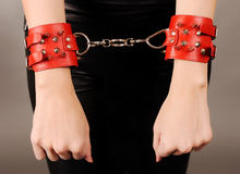 Female hands in handcuffs. Stock Photos