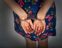 Female hands in handcuffs royalty free stock images