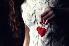 Female hands heart breast love. Female hand holding object shape heart concept stock image
