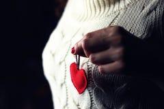 Female hands heart breast love. Female hand holding a heart shape closeup stock photos